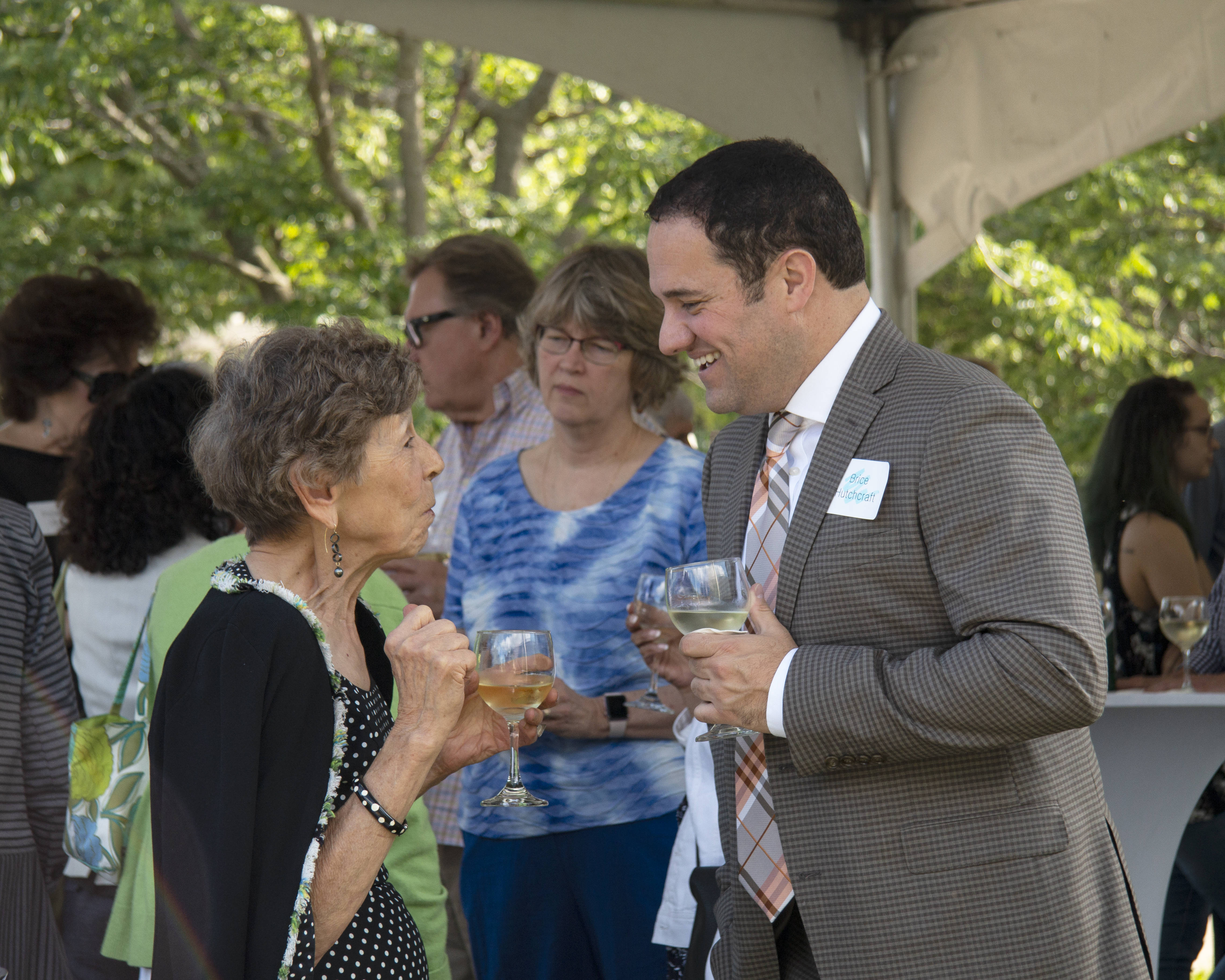 Council Members Jane Myers and Brice Hutchraft enjoy the summer Garden Party, 2019