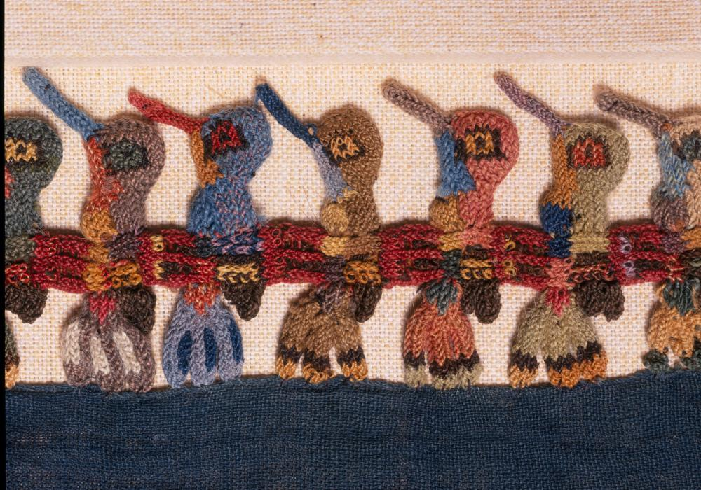 Detail of mantle with hummingbird design, ca. 100 BCE. Peru, Nasca. Cotton, alpaca wool. Gift of Fred Olsen and the Art Acquisition Fund 1967-29-56