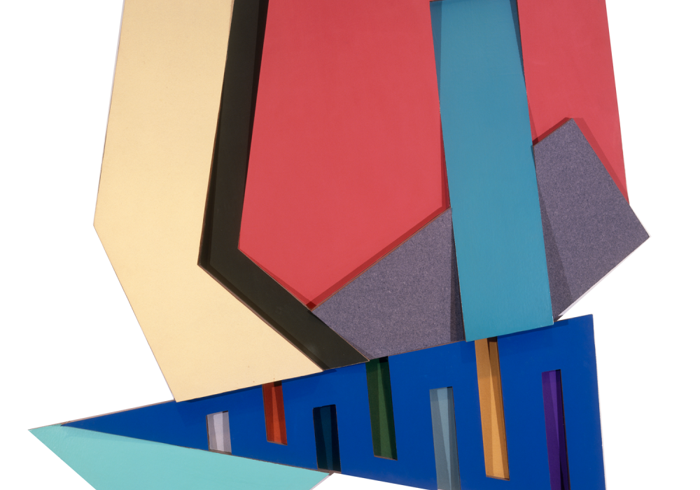 Kozangrodek III by Frank Stella is a large relief collage that is taller than an average man and about as wide. It contains panels of vibrantly colored, smooth material that stand out at angles from each other, forming an abstract citiscape.