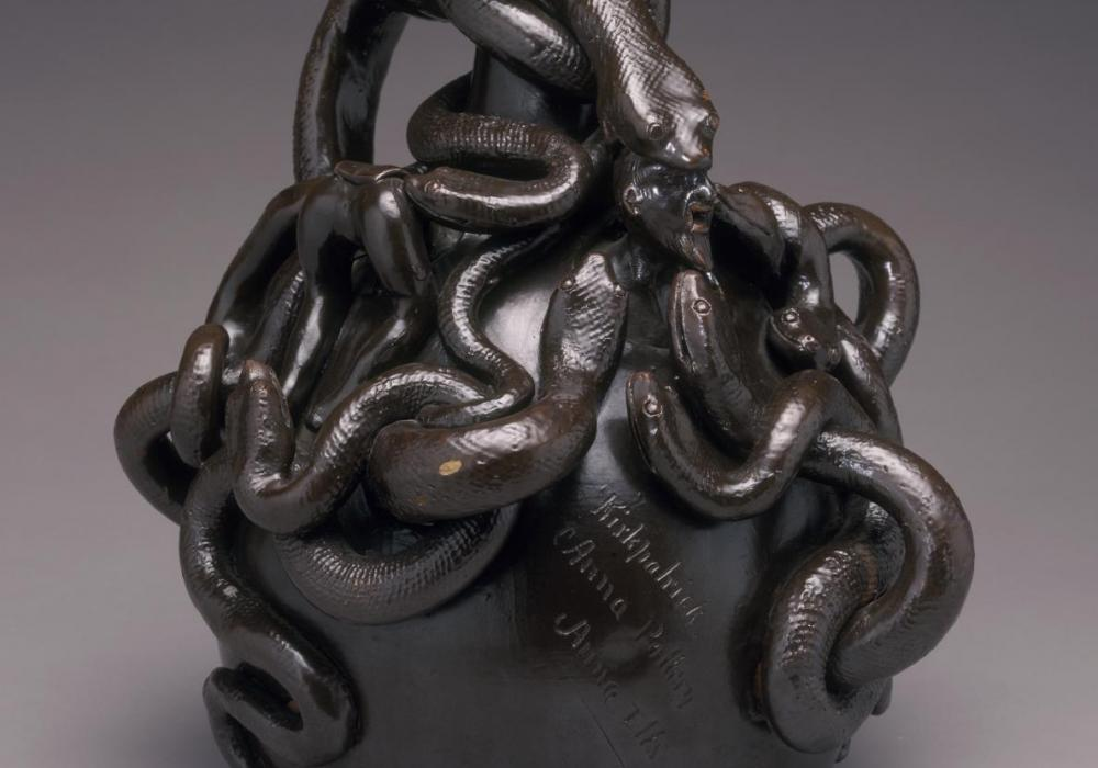 Anna Pottery (Anna, IL), Designer: Wallace Kirkpatrick, Snake Jug, c. 1880–1890. Stoneware with dark brown slip and applied, incised decoration. Gift of the Department of Ceramic Engineering at the University of Illinois, Ries Collection. 1980-5-54