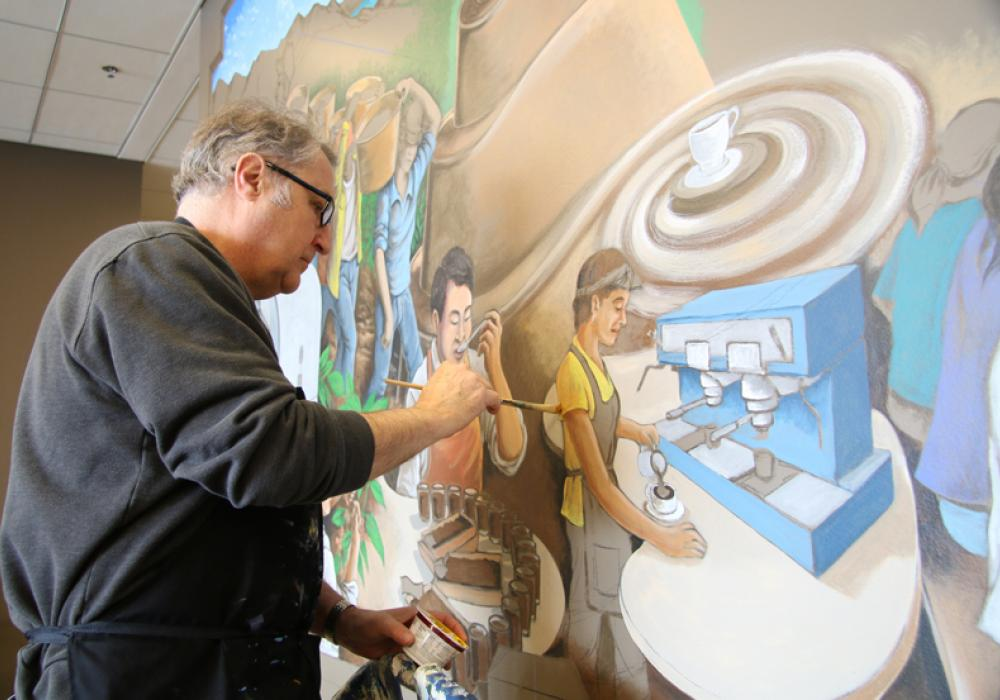 Muralist Glen C. Davies works on a recent project in Ikenberry Commons at the University of Illinois, 2015. Photo by Julia Nucci Kelly