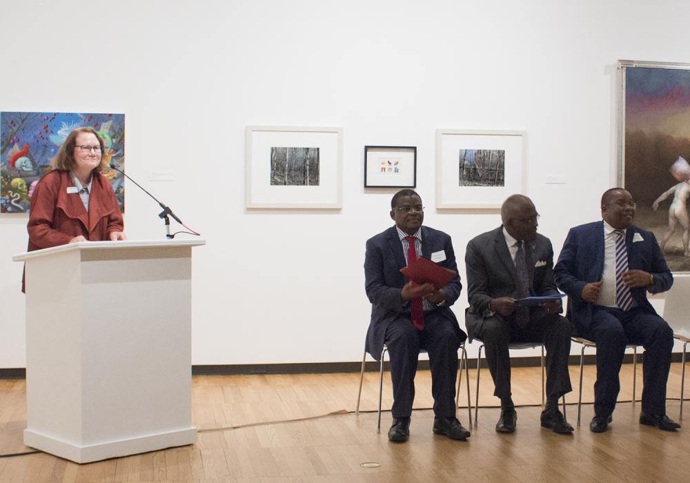 Museum Director Kathleen Harleman, Kenyan Ambassador Robinson Njeru Githae, U of I Chancellor Robert Jones, Director General of the National Museums of Kenya Mzalendo Kibunjia give opening remarks at World on the Horizon: Swahili Arts Across the Indian Oc