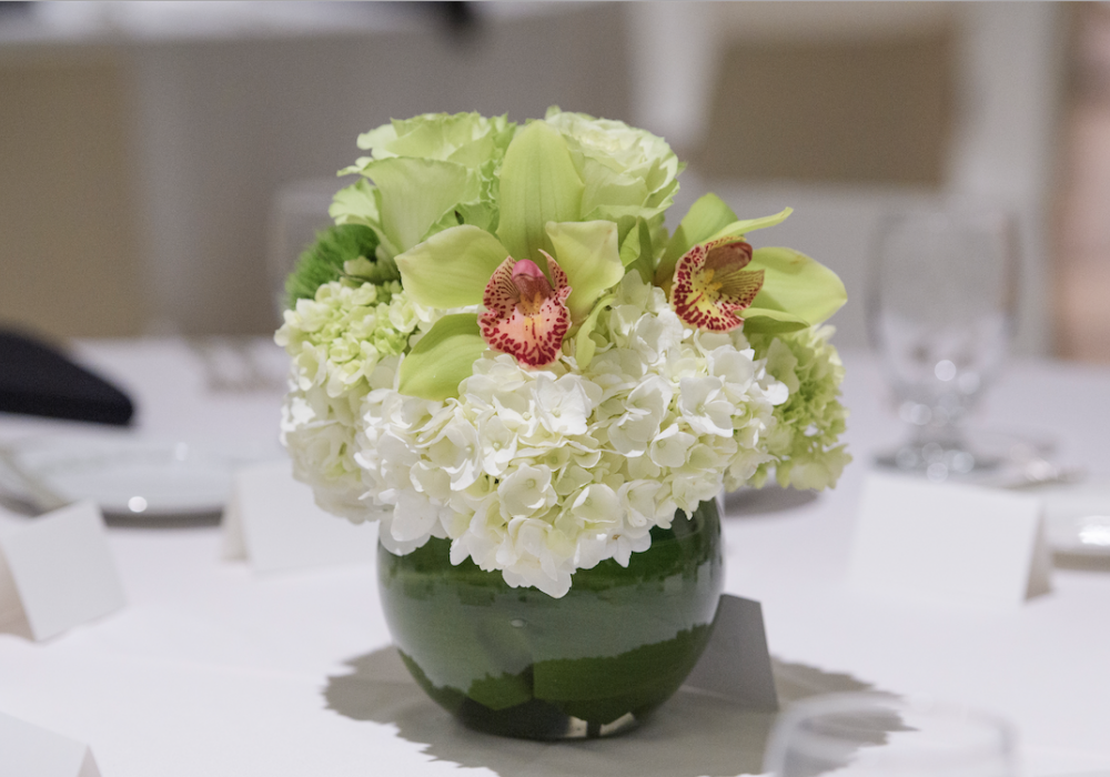 Image of flowers and place settings for gala dinner