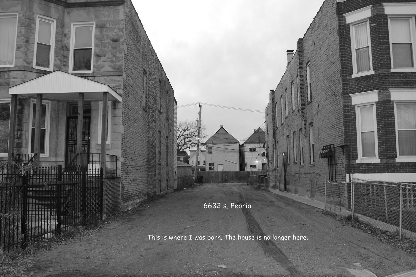 Image of a south side Chicago street framed by identical apartment buildings on either side.