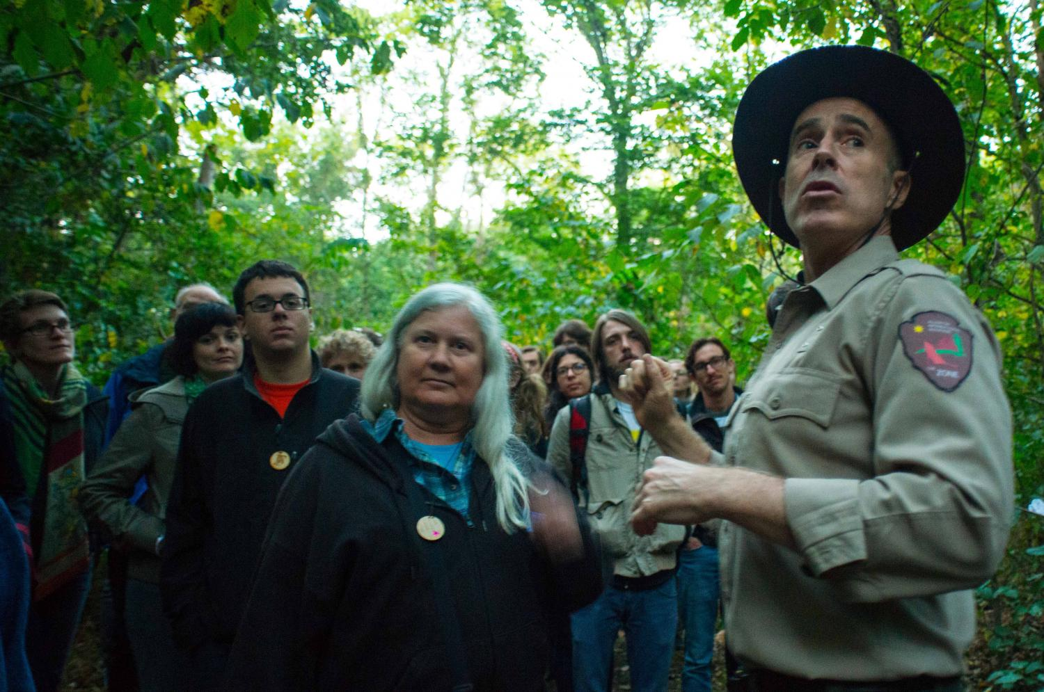 Deke Weaver (as park ranger) interacts with performance participants during The Unreliable Bestiary: Bear, 2017. Photo by Valerie Oliveiro.