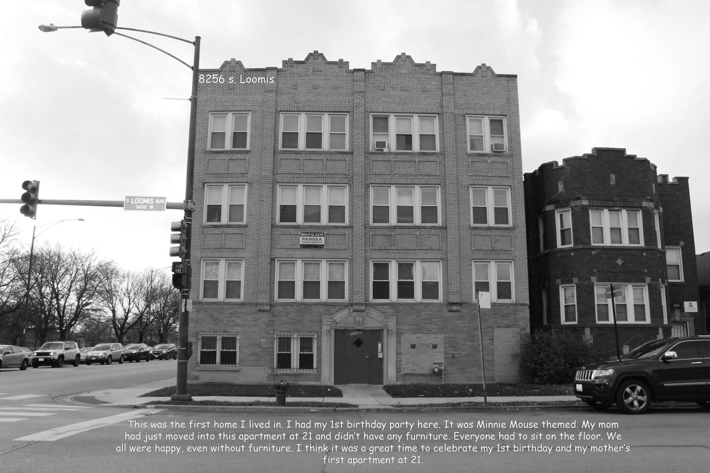 Image of a south side Chicago apartment building with four stories. It is brick with white framed windows.
