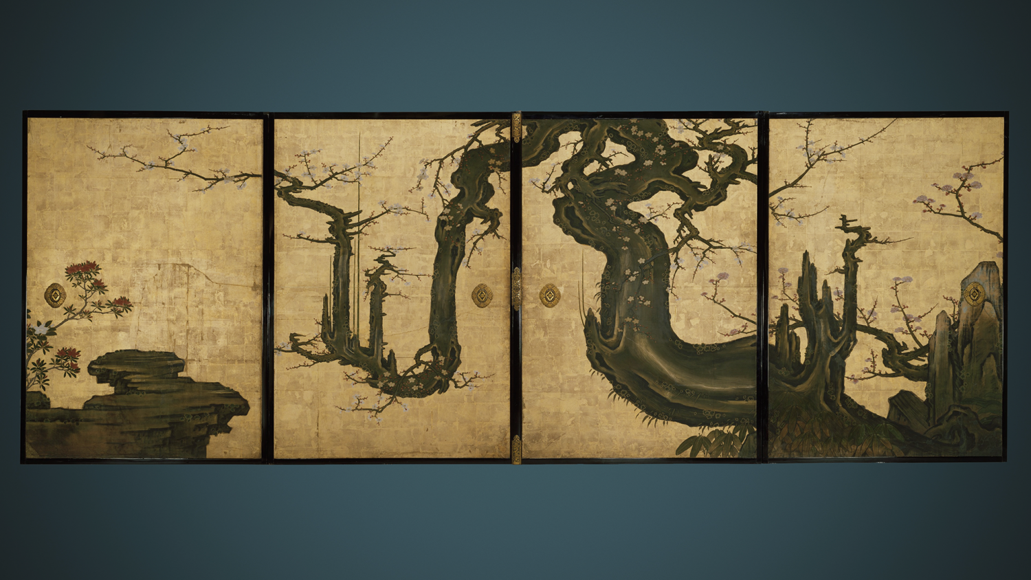 The massive black trunk of an ancient plum tree with bending, twisting branches spans nearly sixteen feet across four sliding panels. The old tree sprouts blossoms. It originally formed one wall of a room in the Tenshōin, a subtemple of Myōshinji.