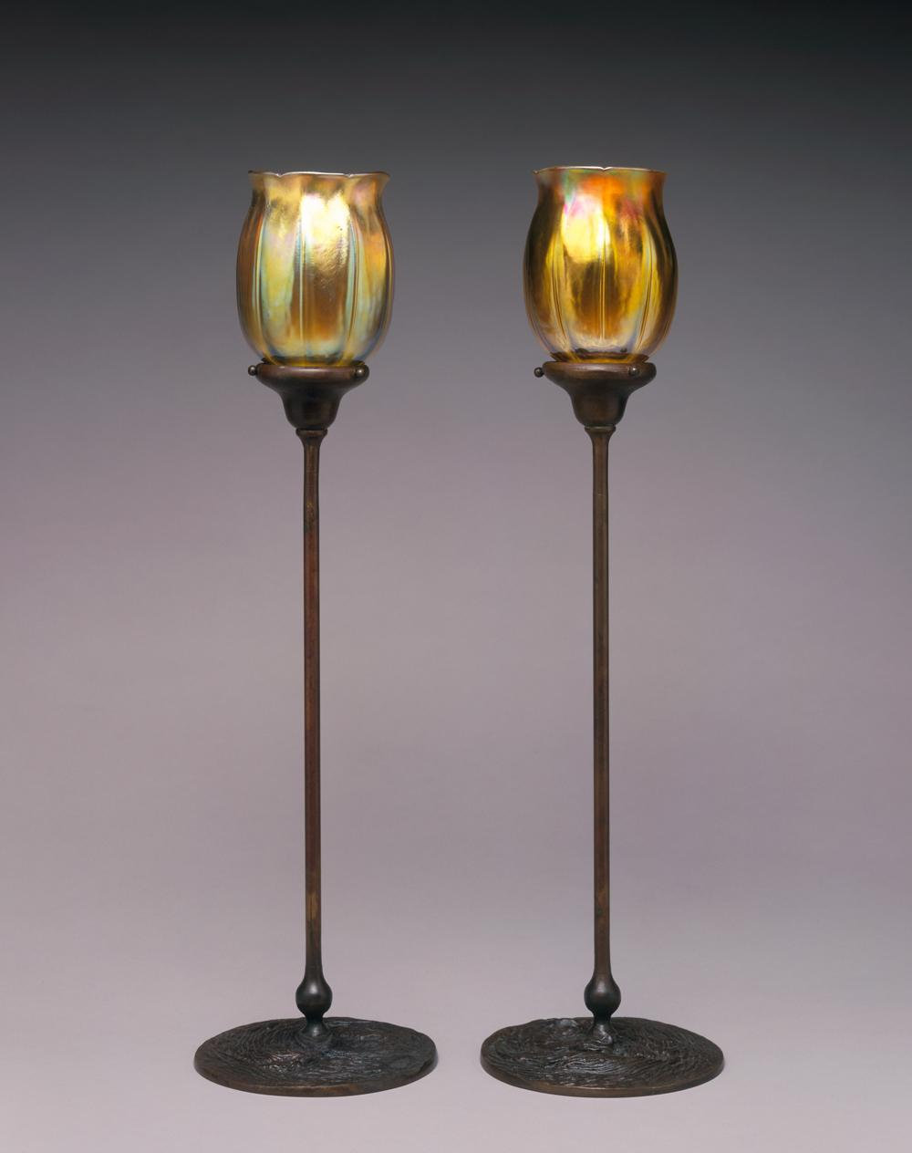 Louis Comfort Tiffany, Favrile Candle Lamps, 1982-16-6_7. Iridescent glass, hand-wrought bronze. Gift of Willis N. and Louis Bruce 1982-16-6, 1982-16-7