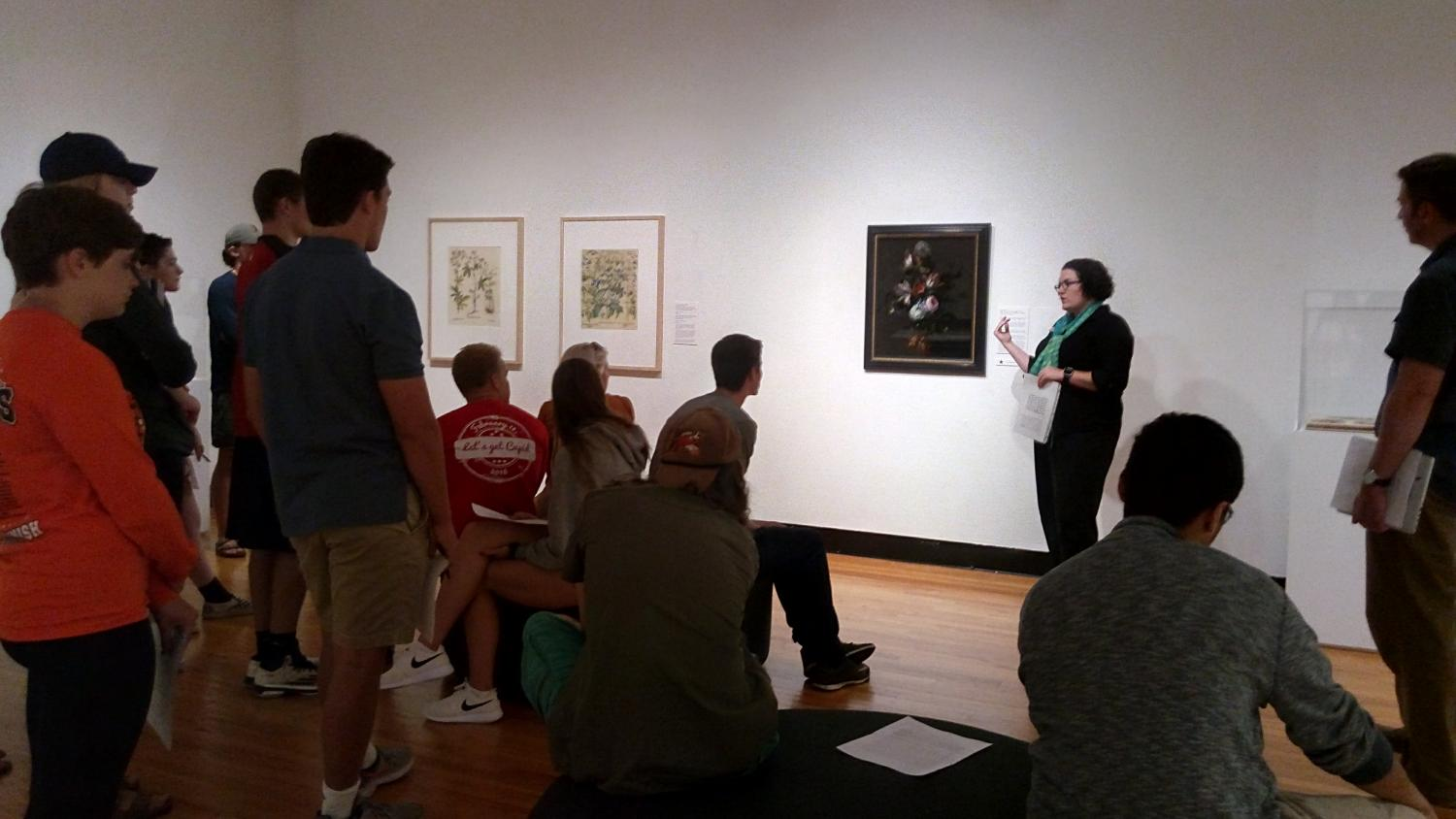 Maureen Warren, curator of European and American Art, talks with students about works on view in Coveting Nature