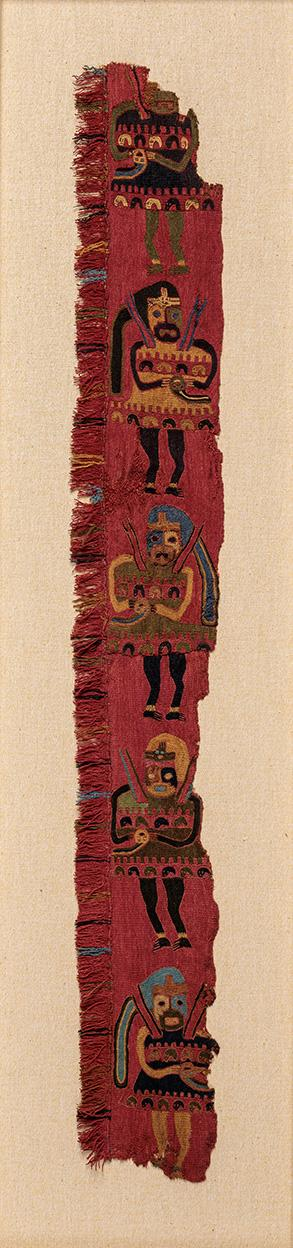 Long strip of ancient red textile with embroidery, framed. It is clearly a fragment.