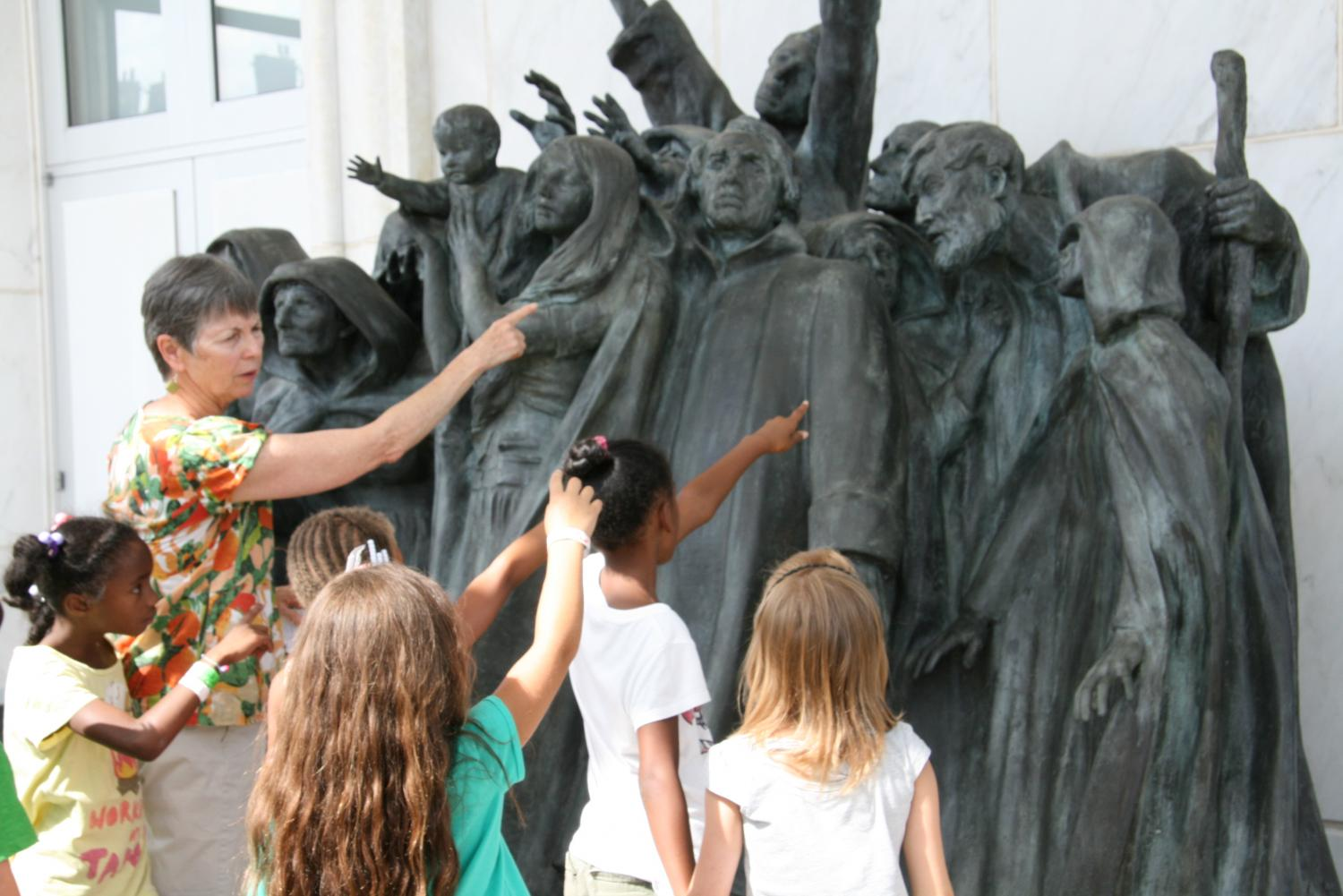 Volunteer Docent talking with students from Champaign Park District, 2013
