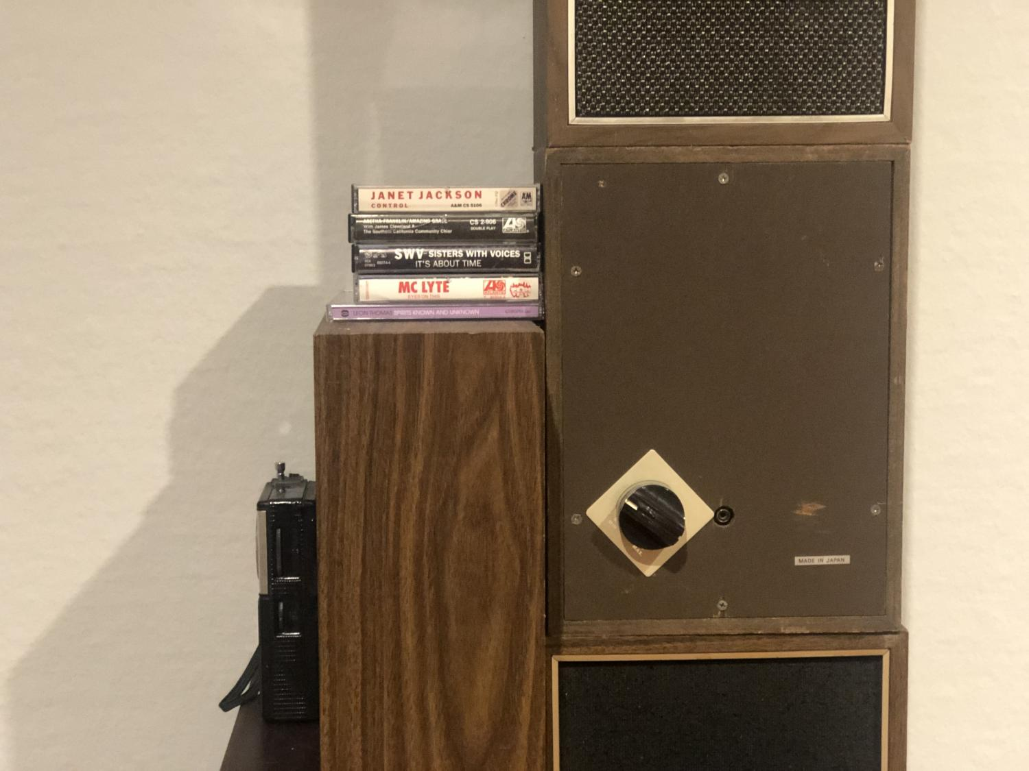 Gallery view of a stack of vintage speakers and cabinets with cassette tapes of favorite music from years ago.