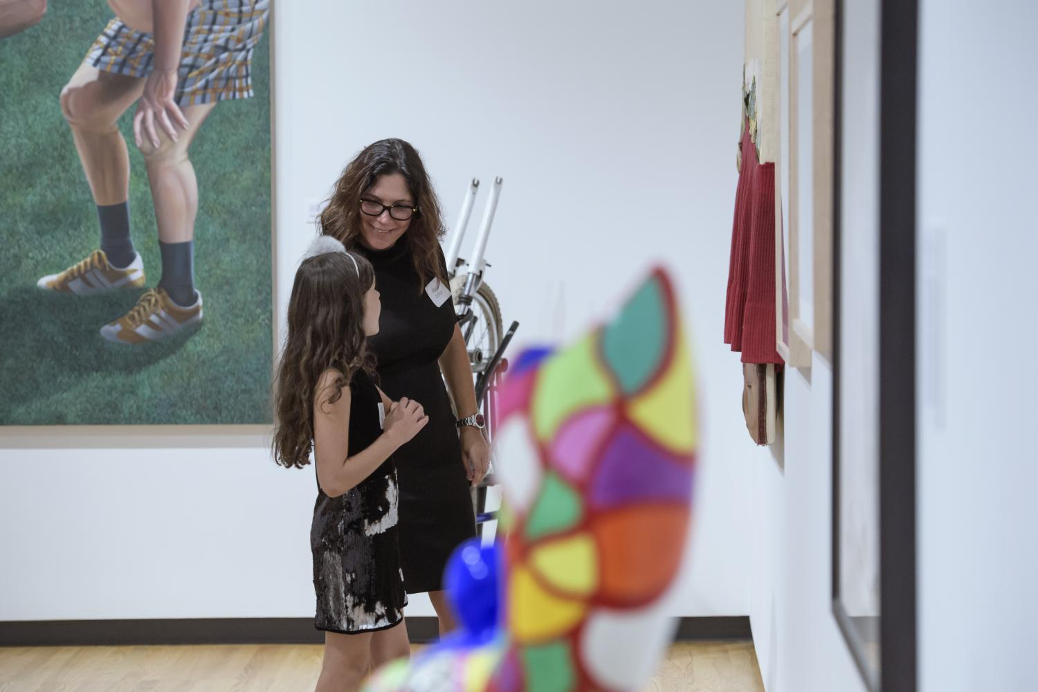 Artwork donor Eva Cohon and her daughter view a special exhibition of work recently added to the collection, including art by Nancy Hild, Bea Nettles, and Niki de Saint-Phalle, 2018. Photo by Della Perrone.