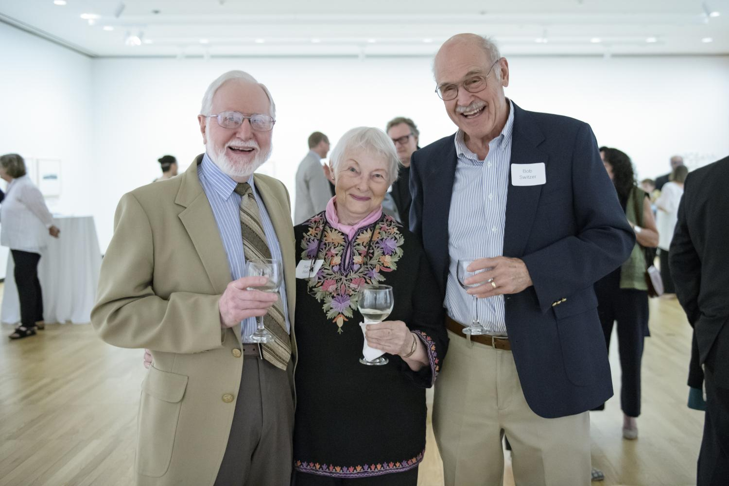 Longtime supporters of Krannert Art Museum George and Sandra Batzli and Bob Switzer celebrate the museum's successful fundraising efforts, 2018. Photo by Della Perrone.