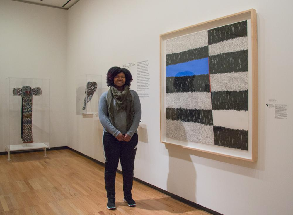 Christina Marbury, senior in the College of Applied Health Sciences, is inspired by the work of Victor Ekpuk installed in Encounters: The Arts of Africa at Krannert Art Museum, 2018
