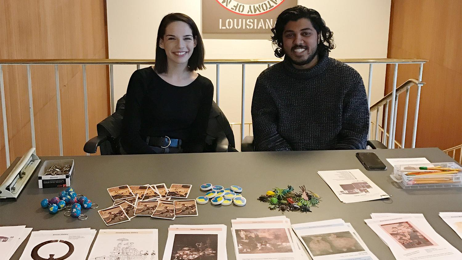 Krannert Art Museum students Aimee Schneider and Samit Sinha prepare to welcome families to Family Walk & Talk, 2017.