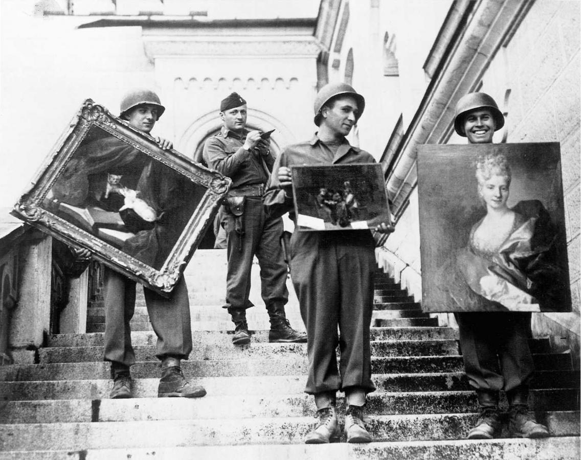 American GIs under the supervision of Captain James Rorimer on the steps of Neuschwanstein castle. Photo credit: U. S. National Archives and Records Administration