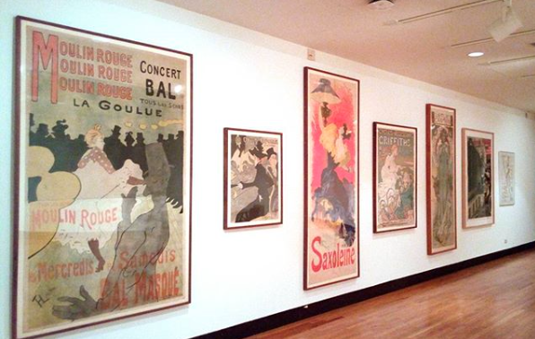 Turn-of-the-century posters from the permanent collection on display in the lower level classroom studio for study by students in graphic design, 2017.