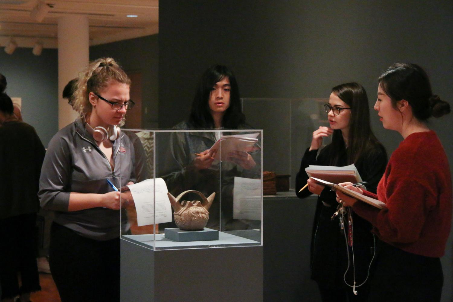 Students from Art in a Global Context examine artworks in the Arts of the Ancient Andes gallery at KAM