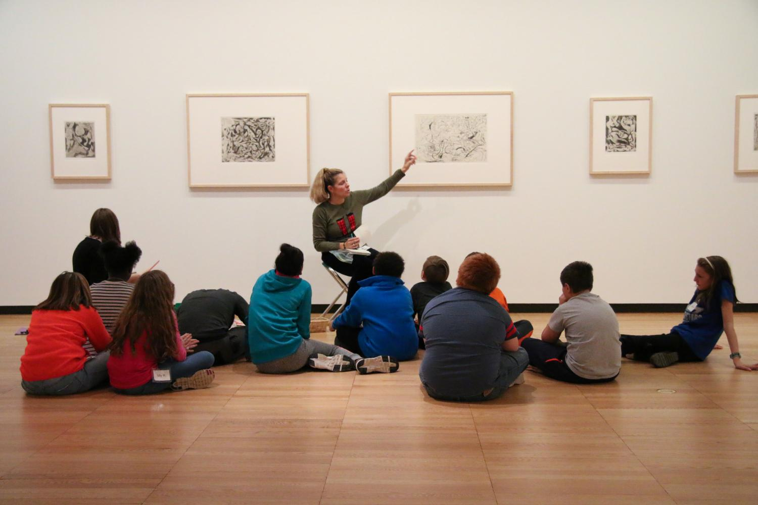 Krannert Art Museum Week at the Museum students from South Side Elementary talk about art in the Gelvin Noel Gallery, 2017.