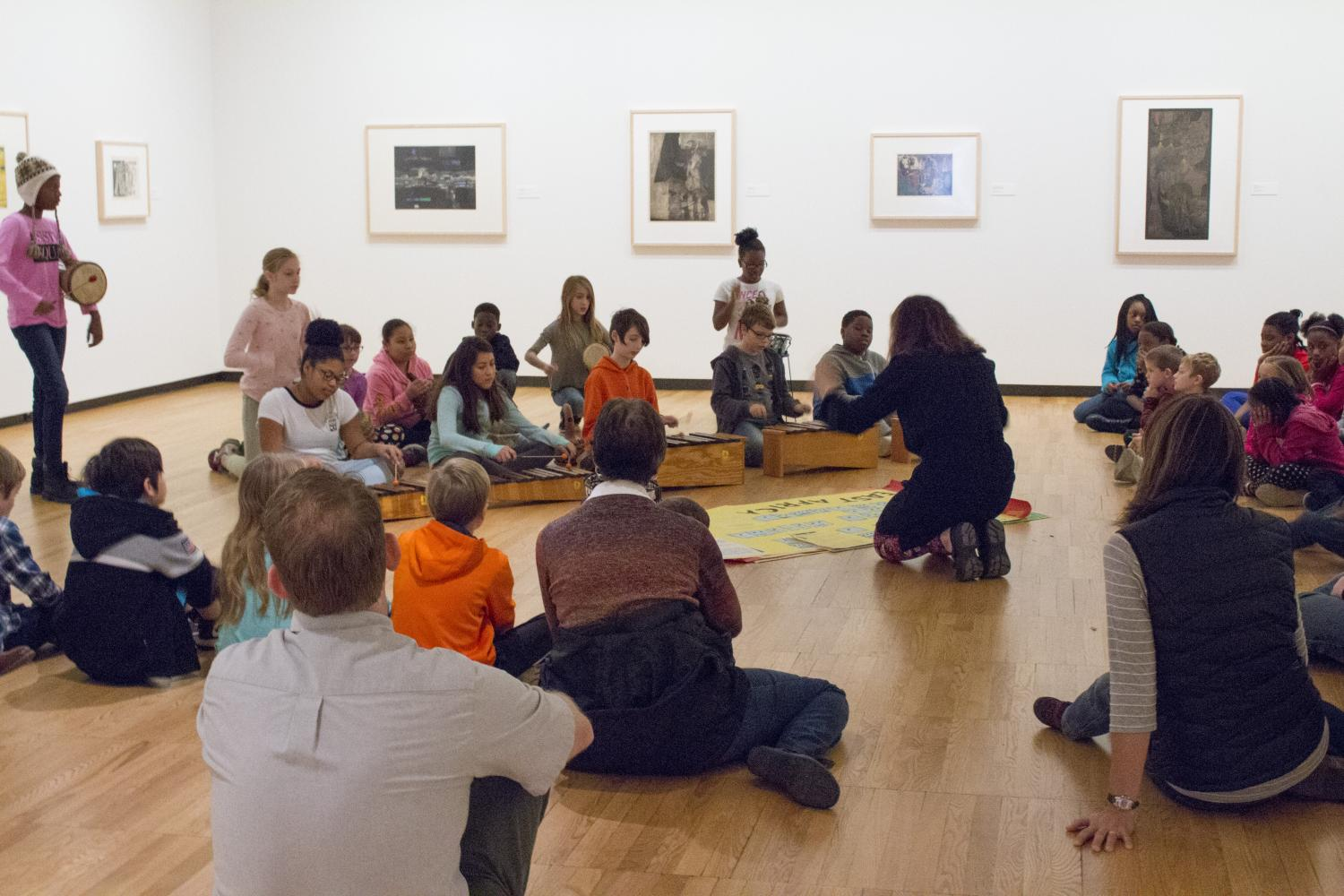 KAM–WAM students from Southside Elementary perform music for parents in the Gelvin Noel Gallery, 2017.