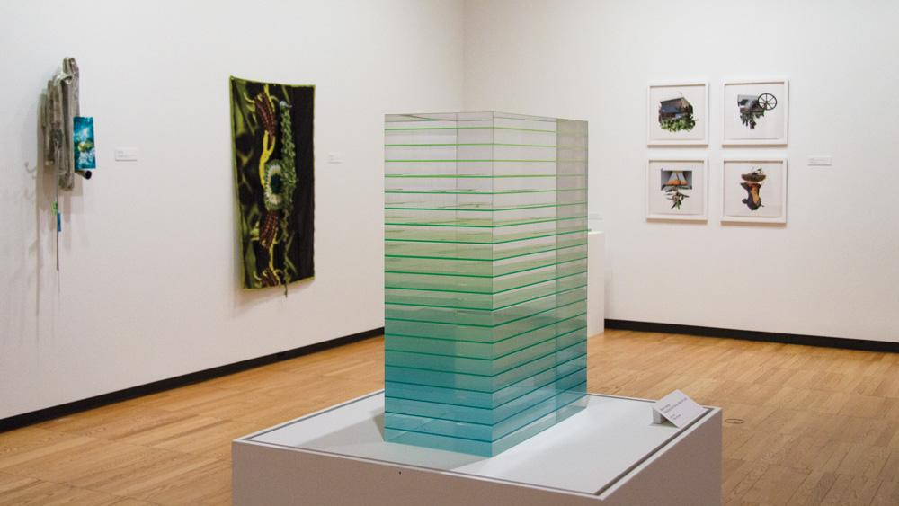 Art by Melissa Pokorny, Stephen Cartwright, and Ryan Griffis in the School of Art + Design Faculty Exhibition, installation at Krannert Art Museum, 2018.