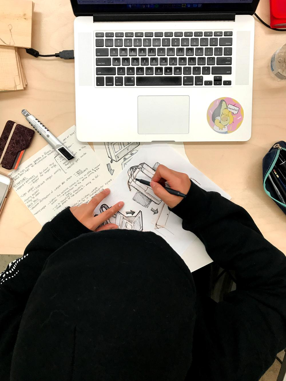 Lulu Guo, A Design Student Sketching in the Studio, 2017. Digital photograph.