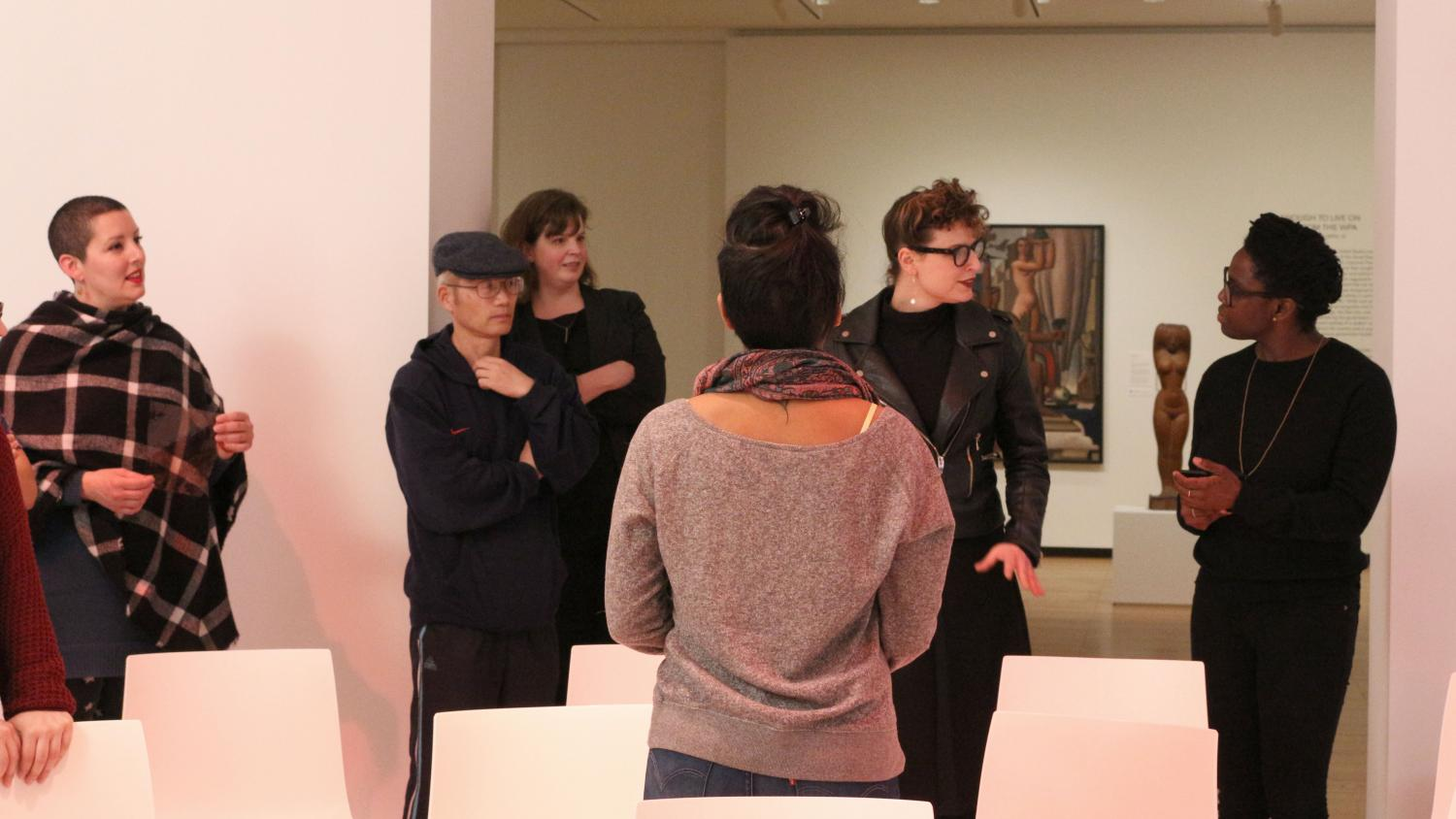 Autumn Knight (far right) and Kelley Hershman converse during the performance of Here and Now at Krannert Art Museum (2017). Photo by Julia Nucci Kelly.