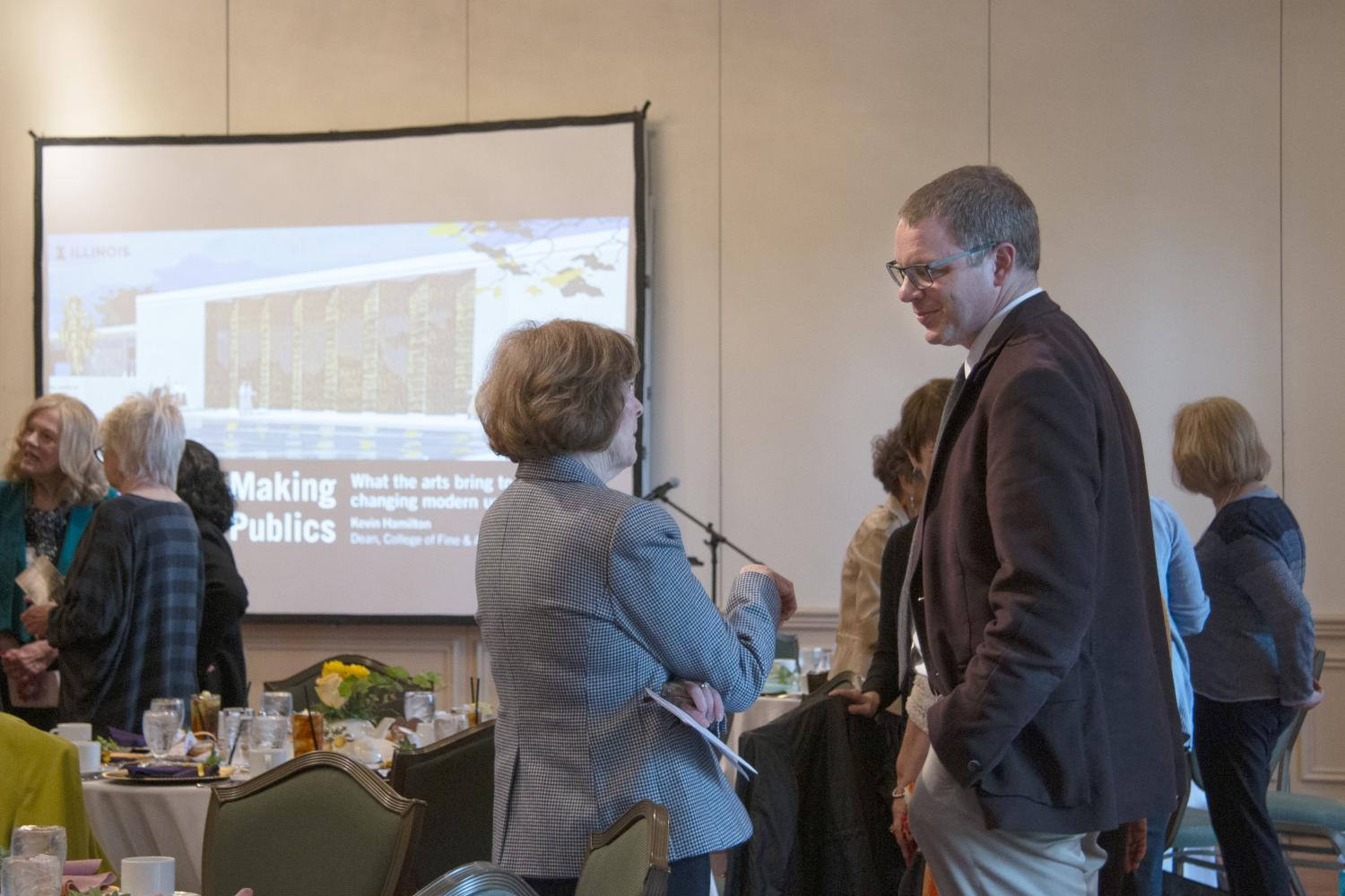 Clare Haussermann talks with Dean Kevin Hamilton of the College of Fine and Applied Arts before the luncheon begins.