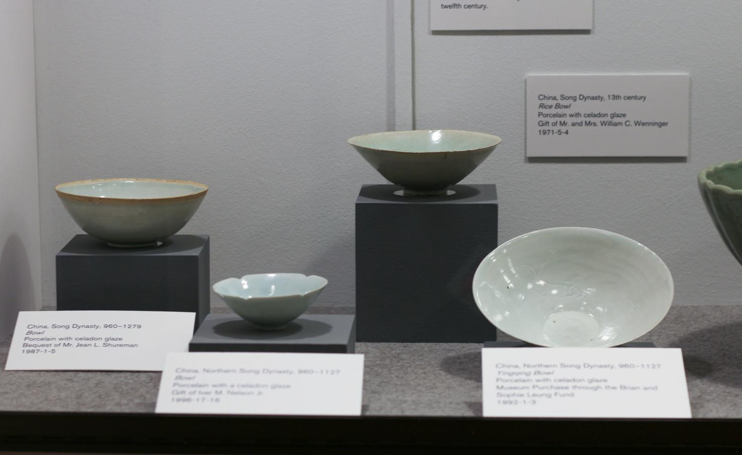 Case of chinese porcelain with pale green glazes. These small, delicate pieces date from as early as the Song dynasty.
