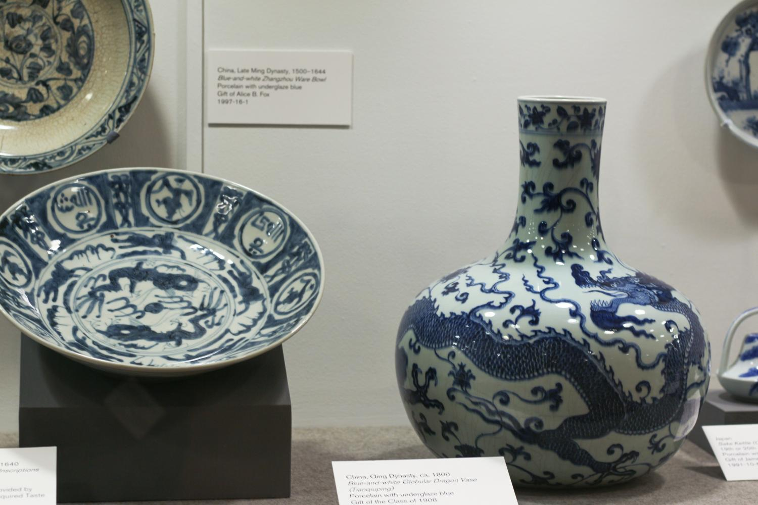 Case of blue and white ceramics, including the museum's large dragon vase. The thickness of the porcelain indicates it was created for export. Thicker porcelain was more difficult to crack during overseas trade.