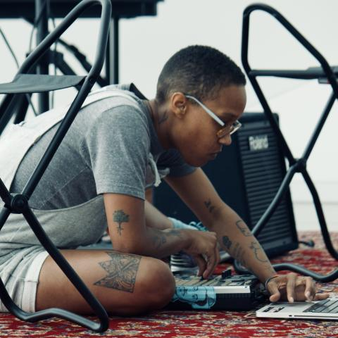Blair Ebony Smith (lovenloops) performs during Black Girl Genius Week, 2019. Courtesy of Saving Our Lives, Hear Our Truths (SOLHOT).